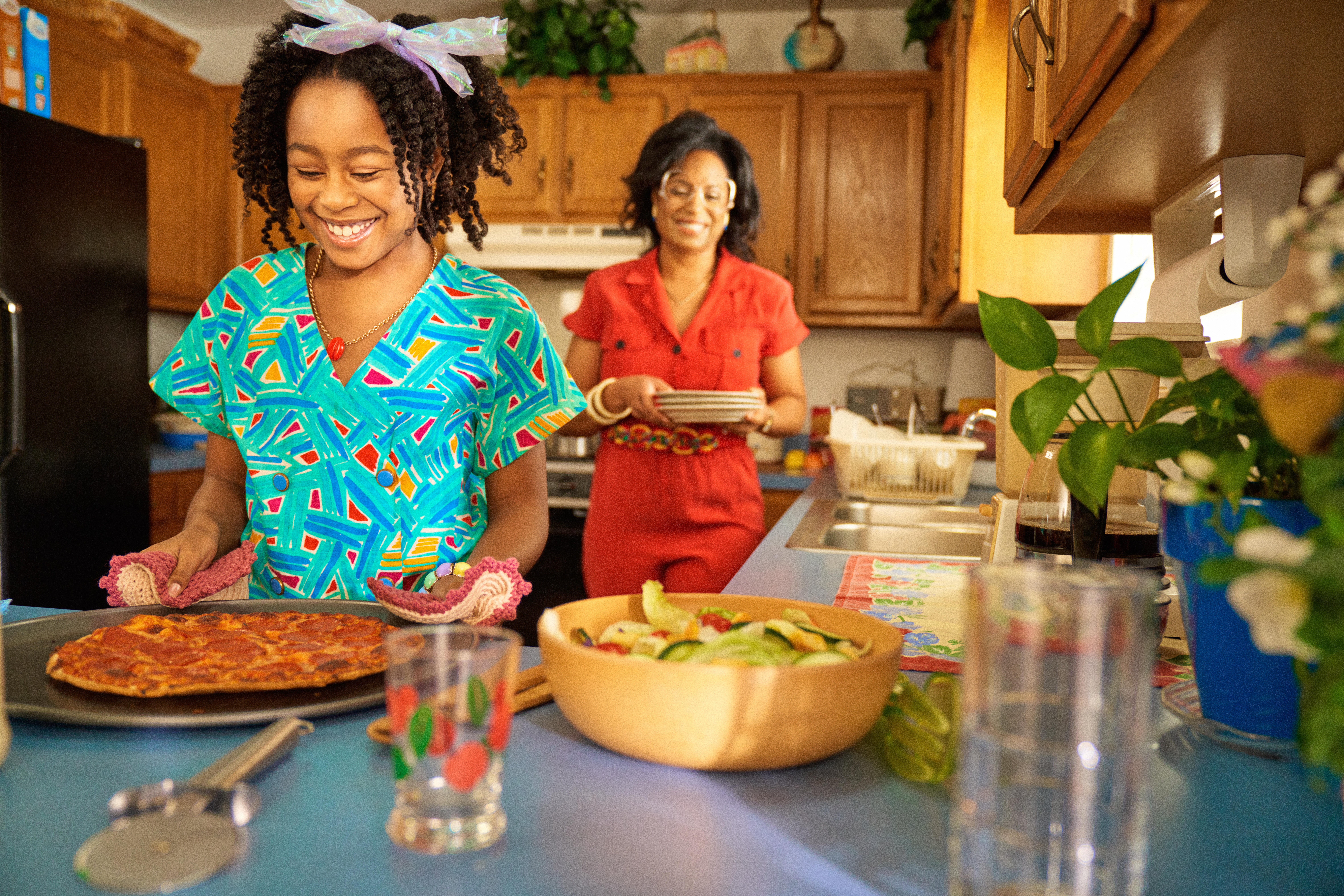 Mom and daughter cooking dinner
