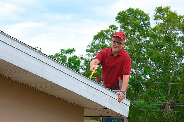 Man working on roof.
