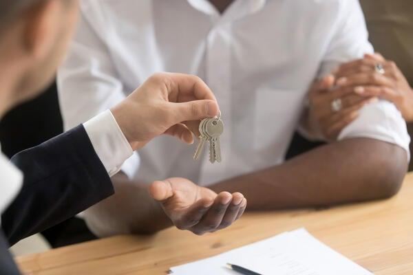 Realtor handing over keys.