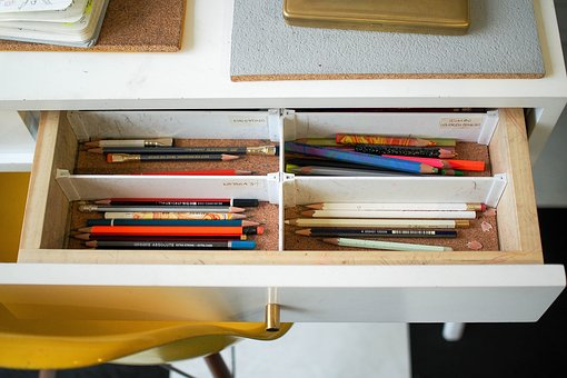 Pencils in a pulled out drawer