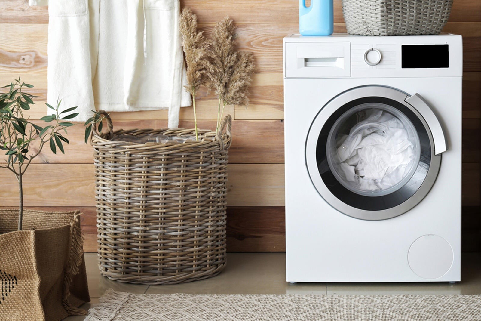 Clothes dryer in a laundry room with damp clothes inside