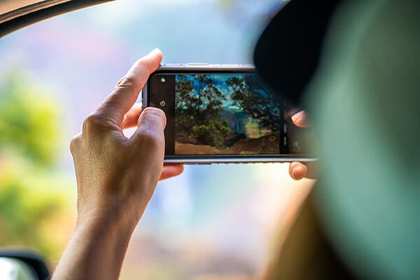 using a phone to video the environment.