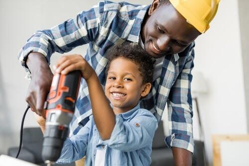 Father and son safely using drill